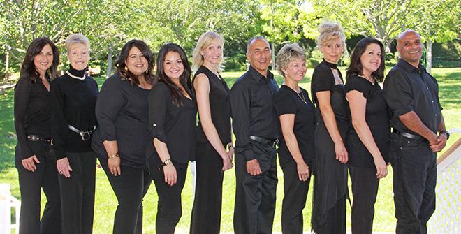 dental staff dressed in black outside